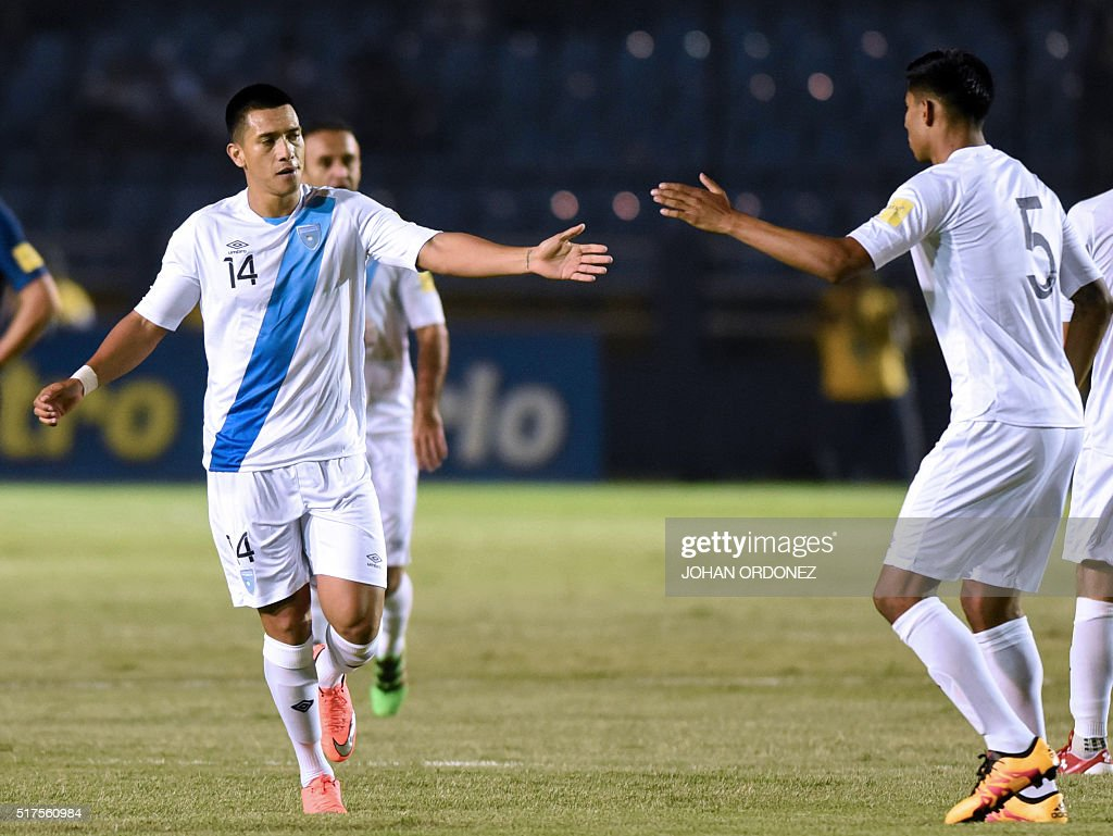 Guatamala's Rafael Morales (L) celebrates with teammate Moises Hernandez after scoring against the United States during their Russia 2018 FIFA World Cup Concacaf Qualifiers' football match, in Guatemala City, on March 25, 2016.