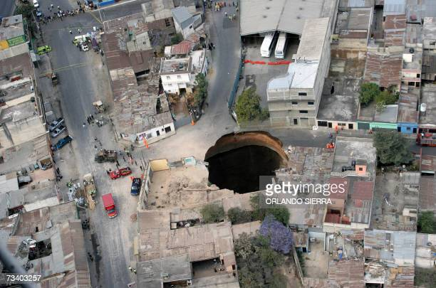 Aerial view of the huge hole caused after a collapse in the sewage system in the neighbourhood of San Antonio north of Guatemala city 23 February...