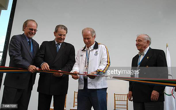 Guatemala City, GUATEMALA: From L to R: president of the IOC organizer committee Willi Kaltschmitt, IOC president Jacques Rogge, Guatemala City's...