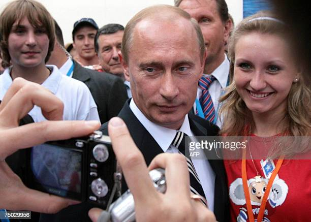 Russian President Vladimir Putin poses for a photograph after the presentation by Sochi at the beginning of the 119th International Olympic Committee...