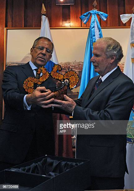 Guatemala City's Mayor Alvaro Arzu , receives a souvenir from Russian Foreign Minister Serguei Lavrov, at the municipality of Guatemala City, on...