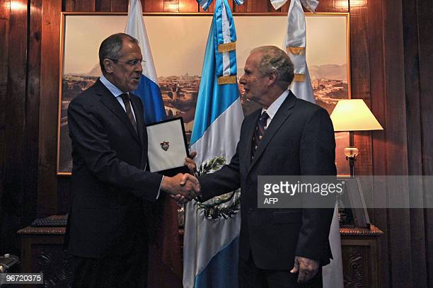 Guatemala City's Mayor Alvaro Arzu , shakes hands with Russian Foreign Minister Serguei Lavrov, at the municipality of Guatemala City, on February...