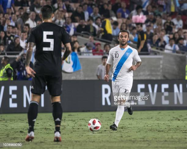 Guatemala midfielder Jose Contreras dribbles the ball as Argentina midfielder Leandro Paredes prepares to defend during the first half of a friendly...