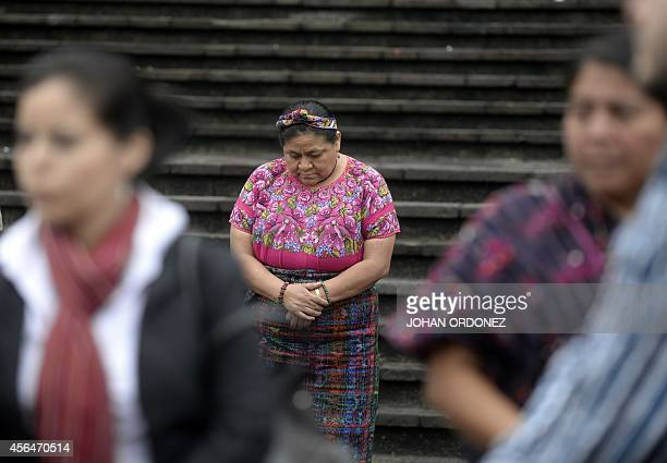 Guatemalan 1992 Nobel Peace Prize laureate Rigoberta Menchu participates in a Mayan religious ceremony in front of the Palace of Justice before the...