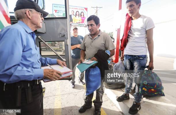 Guatemalan asylum seekers a father and son prepare to board a bus to meet their sponsors in Las Vegas after leaving a shelter for migrants who seek...
