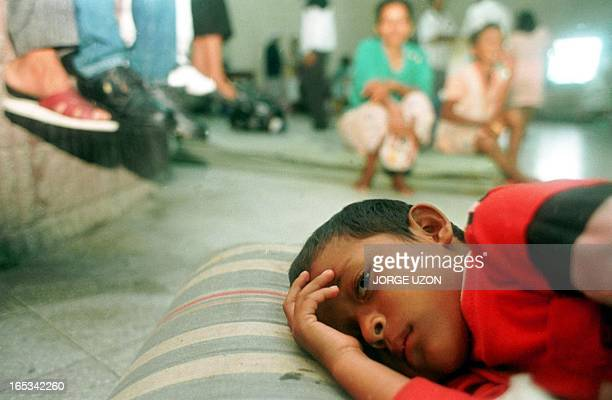 A Guatemalan child rests 28 October in a temporary shelter set for some 400 local residents who were evacuated as authorities are bracing for...