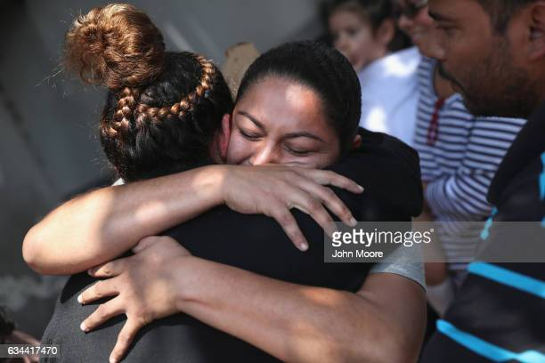 Guatemalan deportee embraces family members after she arrived on an ICE deportation flight on February 9 2017 to Guatemala City Guatemala The charter...