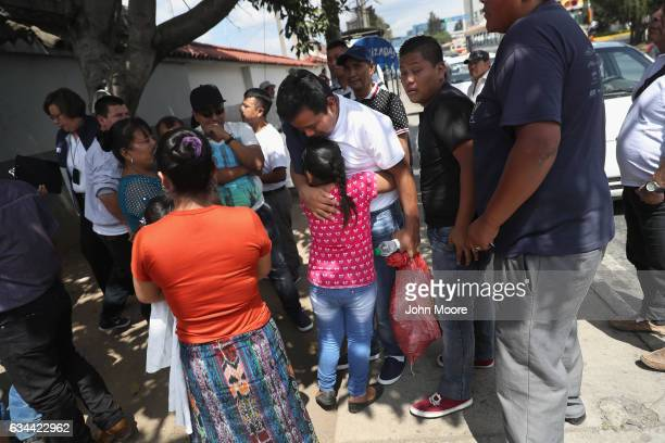 Guatemalan deportee Eric Perez embraces his daughter after he arrived on an ICE deportation flight on February 9 2017 to Guatemala City Guatemala The...