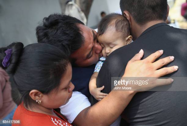 Guatemalan deportee Eric Perez kisses his daughter Kimberly 18 months after he arrived on an ICE deportation flight on February 9 2017 to Guatemala...