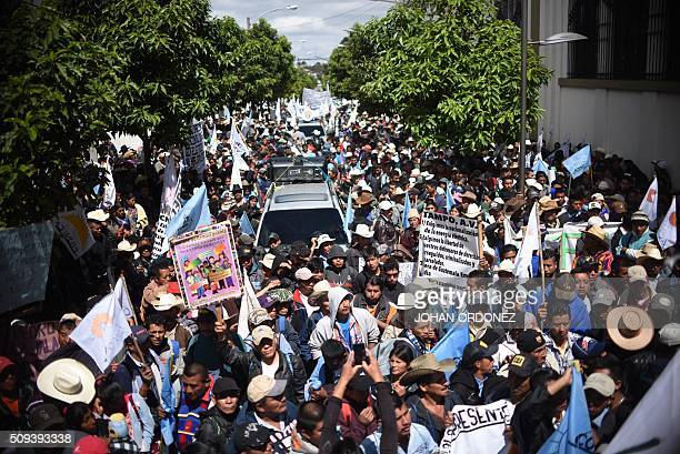 Guatemalan farmers take part in a protest in Guatemala City on February 10 2016 Thousands of farmers marched Wednesday along the streets of the...