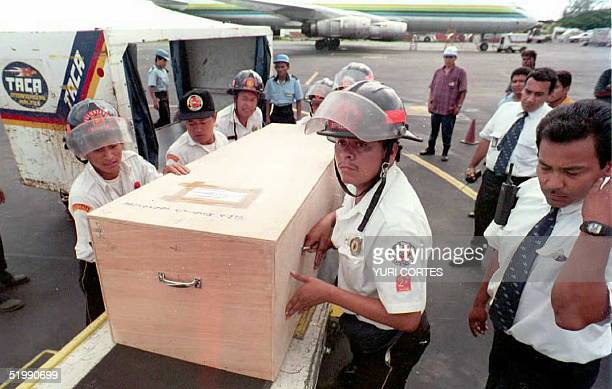 Guatemalan firemen load a casket containing the remains of a Guatemalan victims of the Aviateca flight 901 into a Guatemalan air force plane at the...
