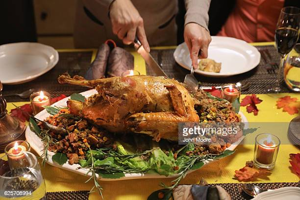 Guatemalan immigrant carves the Thanksgiving turkey on November 24 2016 in Stamford Connecticut Family and friends some of them US citizens others on...