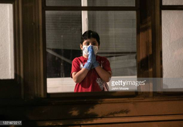 Guatemalan immigrant Junior waits for his mother's ambulance to bring her home from the hospital on April 25 2020 in Stamford Connecticut He and his...