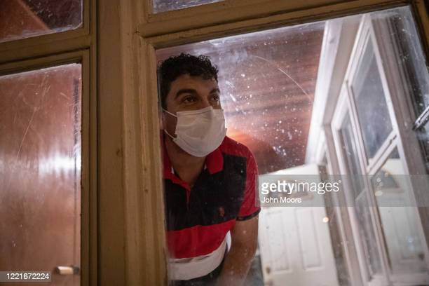 Guatemalan immigrant Marvin waits for his wife's ambulance to arrive from the hospital on April 25 2020 in Stamford Connecticut He and his son Junior...