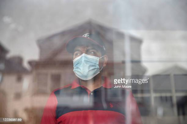 Guatemalan immigrant Marvin watches for a volunteer to arrive and transport his wife Zully for COVID19 testing on May 8 2020 in Stamford Connecticut...
