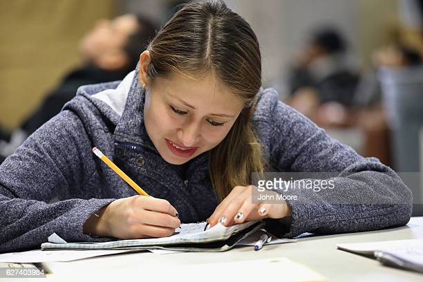 Guatemalan immigrant takes part in an English as a Second Language class on December 3 2016 at an migrants assistance center in Stamford Connecticut...