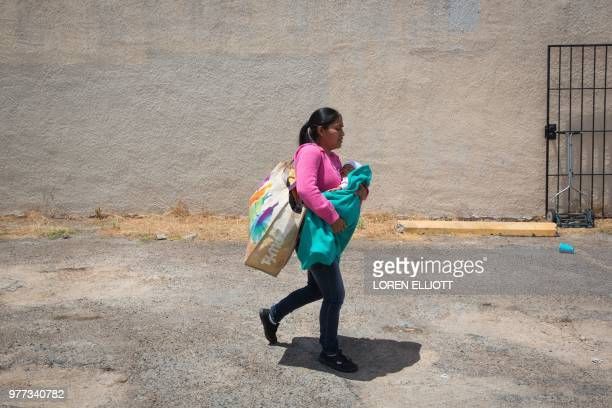 Guatemalan immigrant woman and her infant daughter released from detention through the catch and release policy depart a Catholic Charities relief...
