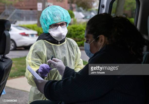 Guatemalan immigrant Zully arrives to a clinic for a COVID19 test on May 8 2020 in Greenwich Connecticut Zully was being retested at the Family...