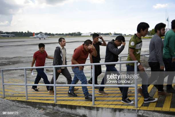 Guatemalan immigrants deported from the United States arrive at the Air Force base in Guatemala City on June 22 2018 A group of 108 Guatemalan...