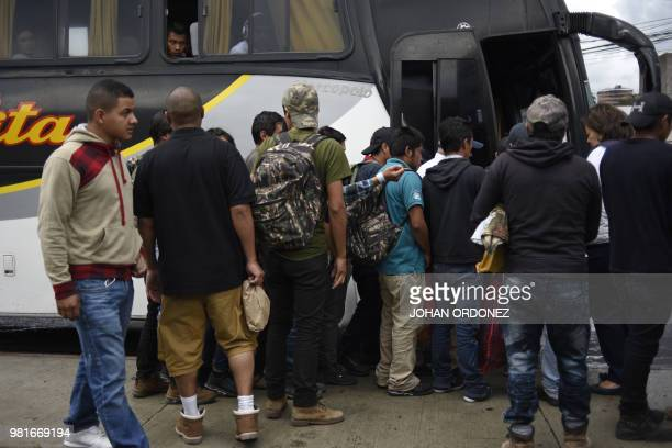 Guatemalan immigrants deported from the United States get on a bus as they leave the Air Force base in Guatemala City on June 22 2018 A group of 108...