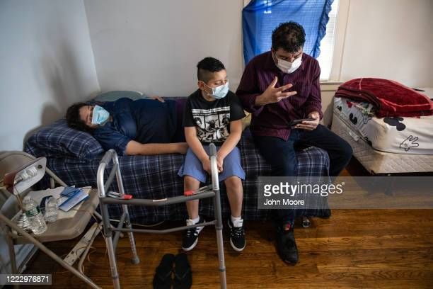 Guatemalan immigrants Marvin Junior and Zully speak to a doctor via Zoom while recovering from COVID19 at home days after Zully returned from weeks...