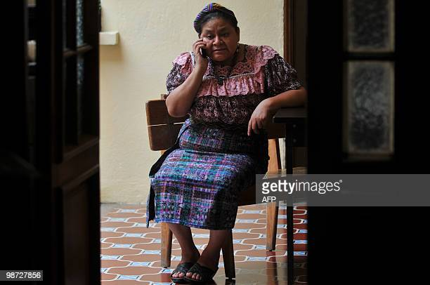 Guatemalan indigenous leader and Nobel Peace Prize Rigoberta Menchu speaks by mobile at the offices of her foundation in Guatemala City April 28 2010...