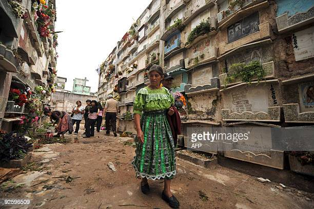 Guatemalan indigenous woman looks for the tomb of a relative at the General cemetery in Guatemala City during the celebration of All Saints Day,...
