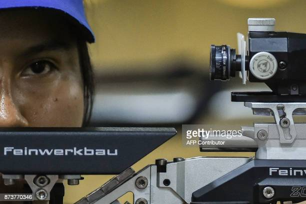 Guatemalan Jazmine Matta competes in the Women's 10m Air Rifle Shooting Final at the XVIII Juegos Bolivarianos in Cali Colombia on November 13 2017 /...