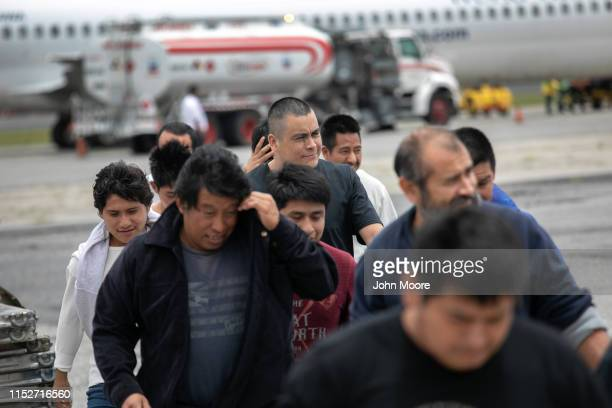 Guatemalan men walk from a deportation flight, chartered by the U.S. Government, after being sent back from the United States on May 30, 2019 in...