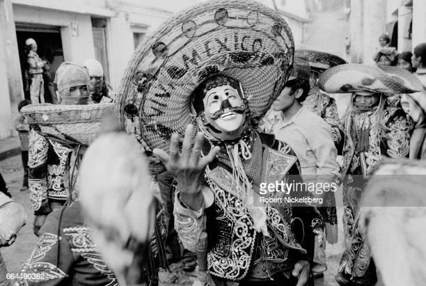 CHICHICASTENANGO GUATEMALA DECEMBER 20 Guatemalan men wearing Spanish conquistador masks dance during the Fiesta de Santo Tomás December 20 1981 in...