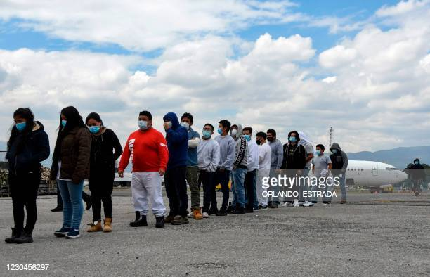 Guatemalan migrants deported from the United States, queue upon their arrival at the Air Force Base in Guatemala City on January 6, 2021. - During...