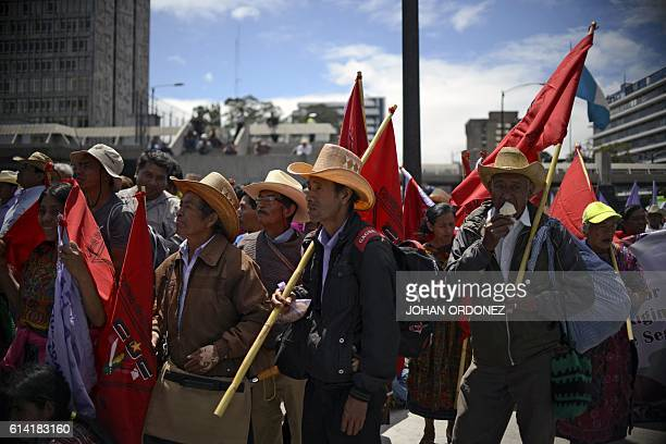 Guatemalan natives and peasants march against mine exploitation in Guatemala City on October 12 during Columbus Day / AFP / JOHAN ORDONEZ