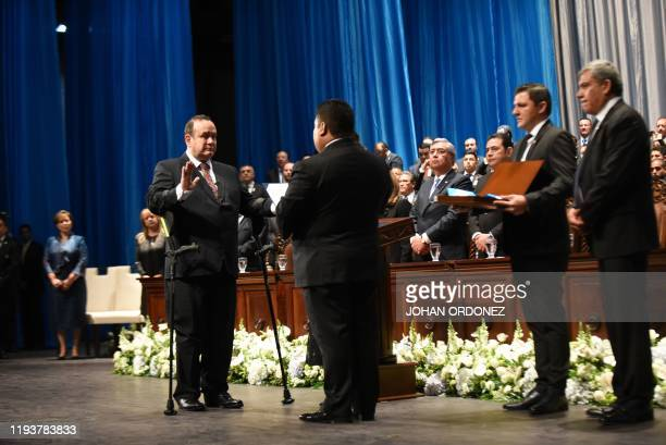 Guatemalan new President Alejandro Giammattei swears in during his inauguration ceremony at the National Theater in Guatemala City on January 14 2020...