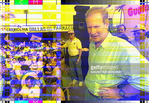 Guatemalan opposition leading presidential candidate Alvaro Arzu checks the crowd at a campagin rally 04 November in Ciudad Peronia,a suburb of the...