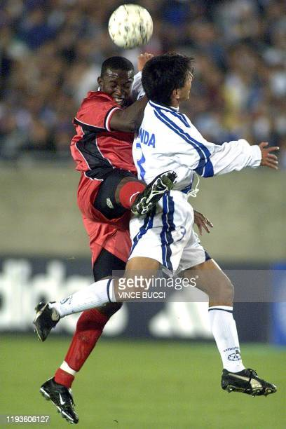 Guatemalan player Erick Miranda fights for the ball with Trinidad and Tobago player Dwight Yorke during the first half of their Gold Cup match...