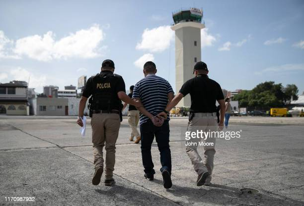 Guatemalan police escort a convicted criminal who arrived on an ICE deportation flight from Brownsville, Texas on August 29, 2019 to Guatemala City....