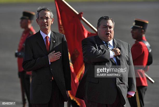 Guatemalan President Alvaro Colom and El Salvador's Vice Foreign Minister Luis Montes listen El Salvador's national anthem upon Colom's arrival to El...
