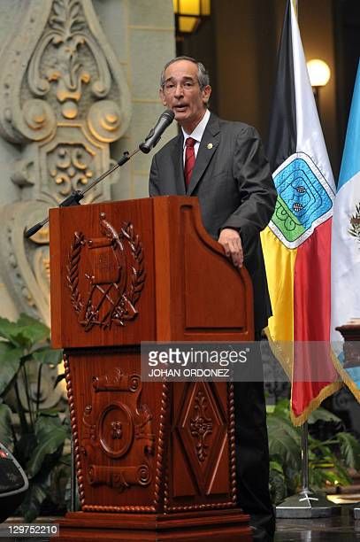 Guatemalan president Alvaro Colom speaks on October 20 at the Culture Palace in Guatemala City The Guatemalan state apologized to the family of...