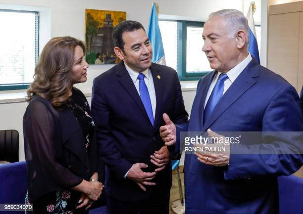 Guatemalan President Jimmy Morales and his wife Hilda Patricia Marroquin speak with Israeli Prime Minister Benjamin Netanyahu ahead of the...