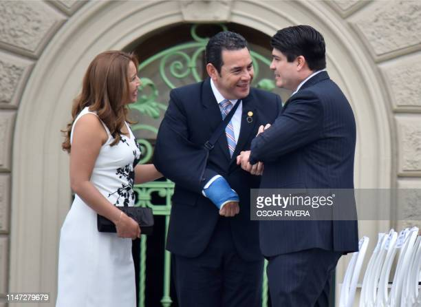 Guatemalan President Jimmy Morales and his wife Patricia Marroquin chat with Costa Rican President Carlos Alvarado upon arriving for the inauguration...