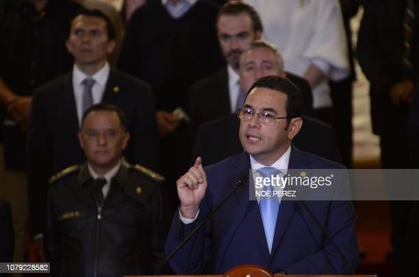 Guatemalan President Jimmy Morales flanked by his cabinet gives a statement at the Culture Palace in Guatemala City on January 7 2019 Morales...