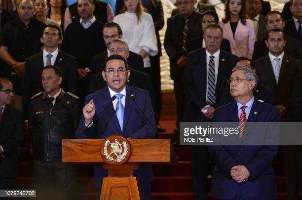 Guatemalan President Jimmy Morales flanked by VicePresident Jafeth Cabrera and his cabinet gives a statement at the Culture Palace in Guatemala City...