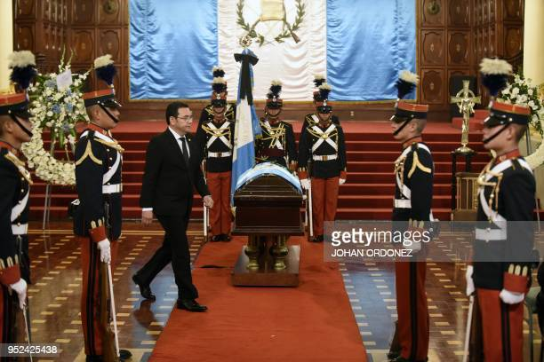 Guatemalan President Jimmy Morales walks next to the coffin of former Guatemalan President and Guatemala City Mayor Alvaro Arzu during his funeral at...
