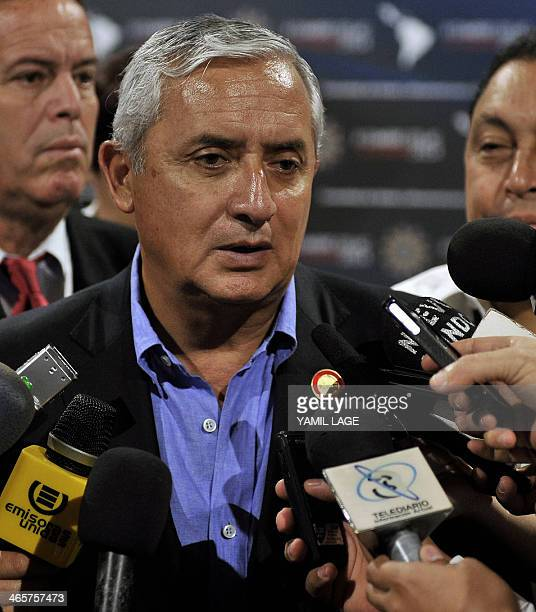 Guatemalan President Otto Perez Molina gives a press conference during the II Summit of the Community of Latin American and Caribbean States in...