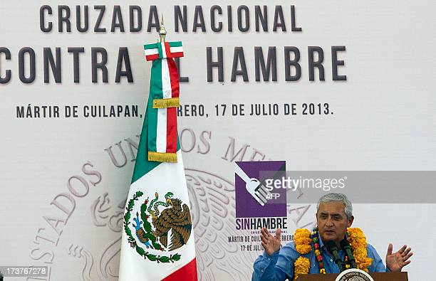 Guatemalan President Otto Perez Molina speaks during an event within the National Crusade against Hunger campaign in the town of Apango Martir de...