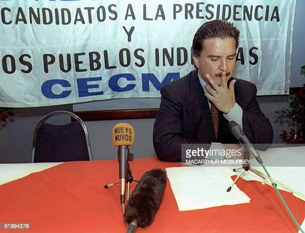 Guatemalan presidential candidate Alfonso Portillo of the Guatemalan Republican Front waits in vain for rival candidate Alvaro Arzu of the National...