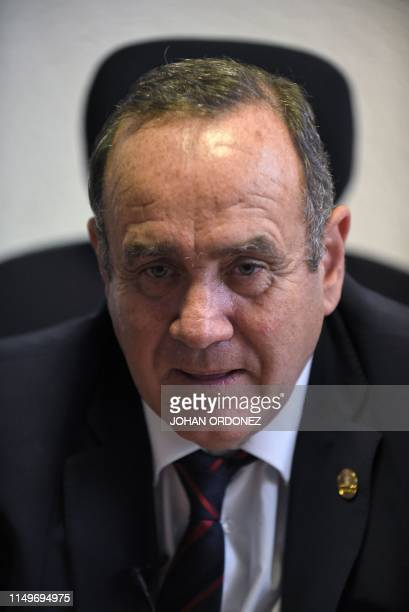 Guatemalan presidential candidate for the Vamos party, Alejandro Giammattei, offers an interview to AFP at his office in Guatemala City, on June 12...