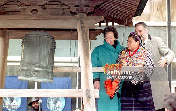 Guatemalan Rigoberta Menchu rings the peace bell at the United Nations 20 March 1993 at 0941 hours EST the moment of the Vernal Equinox Menchu won...