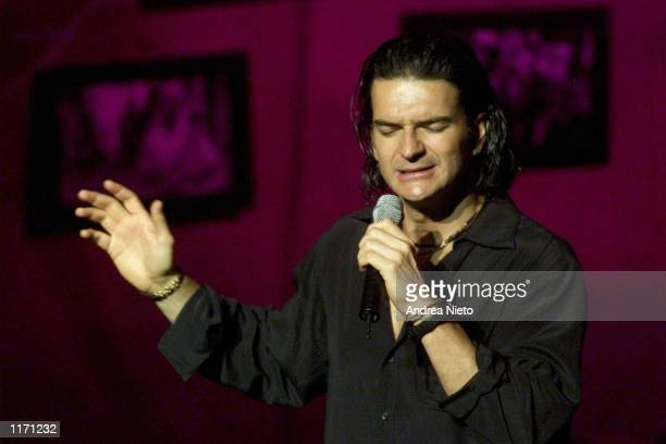 Guatemalan singer Ricardo Arjona sings a song from his new album titled 'Galeria Caribe' October 19 2001 in Guatemala City One song named ''El...