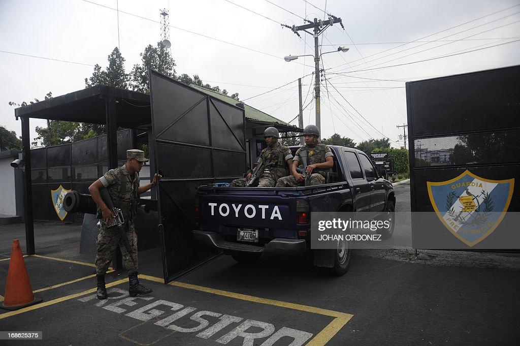 Guatemalan soldiers arrive at the Matamoros military prison where former Guatemalan de facto President (1982-1983), retired General Jose Efrain Rios Montt is serving sentence, in Guatemala city on May 12, 2013. Rios Montt was found guilty of genocide and war crimes on May 10 and sentenced to 80 years in prison in a landmark ruling stemming from massacres of indigenous people in his country's long civil war. Rios Montt thus became the first Latin American convicted of trying to exterminate an entire group of people in a brief but particularly gruesome stretch of a war that started in 1960, lasted 36 years and left around 200,000 people dead or missing. AFP PHOTO / Johan ORDONEZ